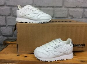 on sale latest fashion order online Details about REEBOK CHILDREN UK 3.5 EU19.5 WHITE LEATHER CLASSIC TRAINERS  SILVER GLITTER HEE