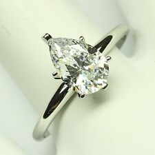 ENGAGEMENT RING WITH A 1.50 PEAR SHAPE 14 KARAT GOLD
