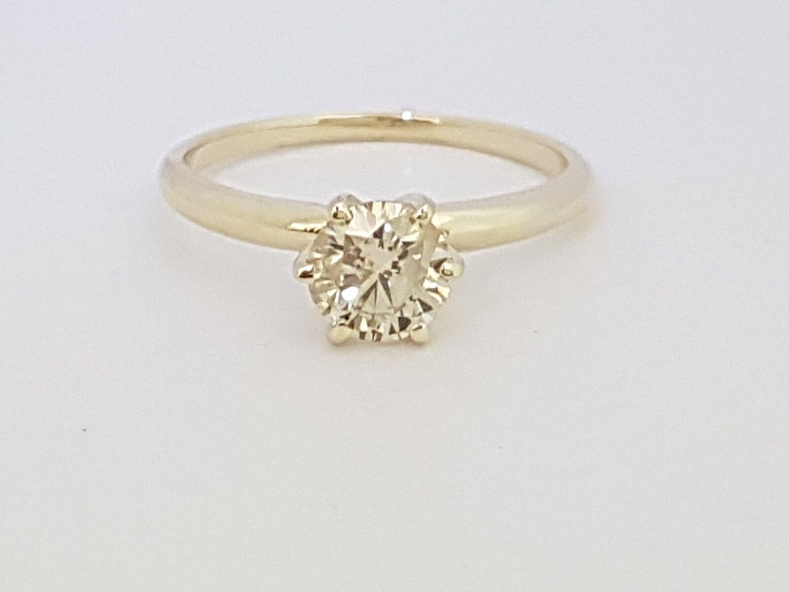 0.75 ct round cut 14K yellow gold diamond engagement ring J SI2