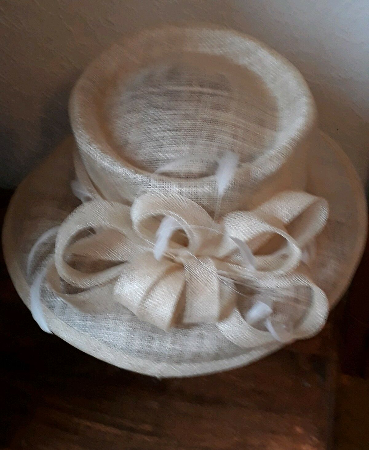 Lovely wedding formal races hat natural colour with swirl and feather detail