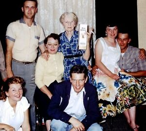7542a4aeb5d Slide 1950 s Family Photo Granny Smoking Cigarette Holding Old Stagg ...