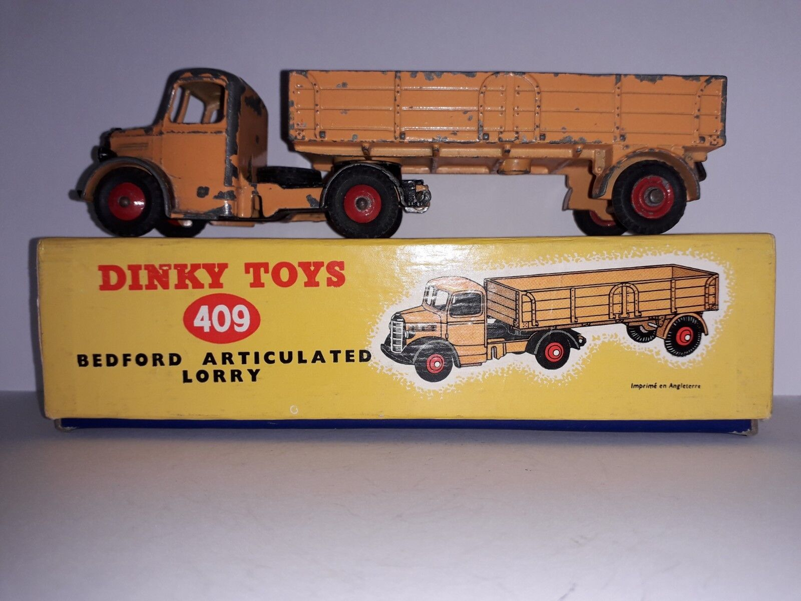 En Caja Dinky Toys 409 Bedford Articulado camión arancia camión nero Grill & Wings