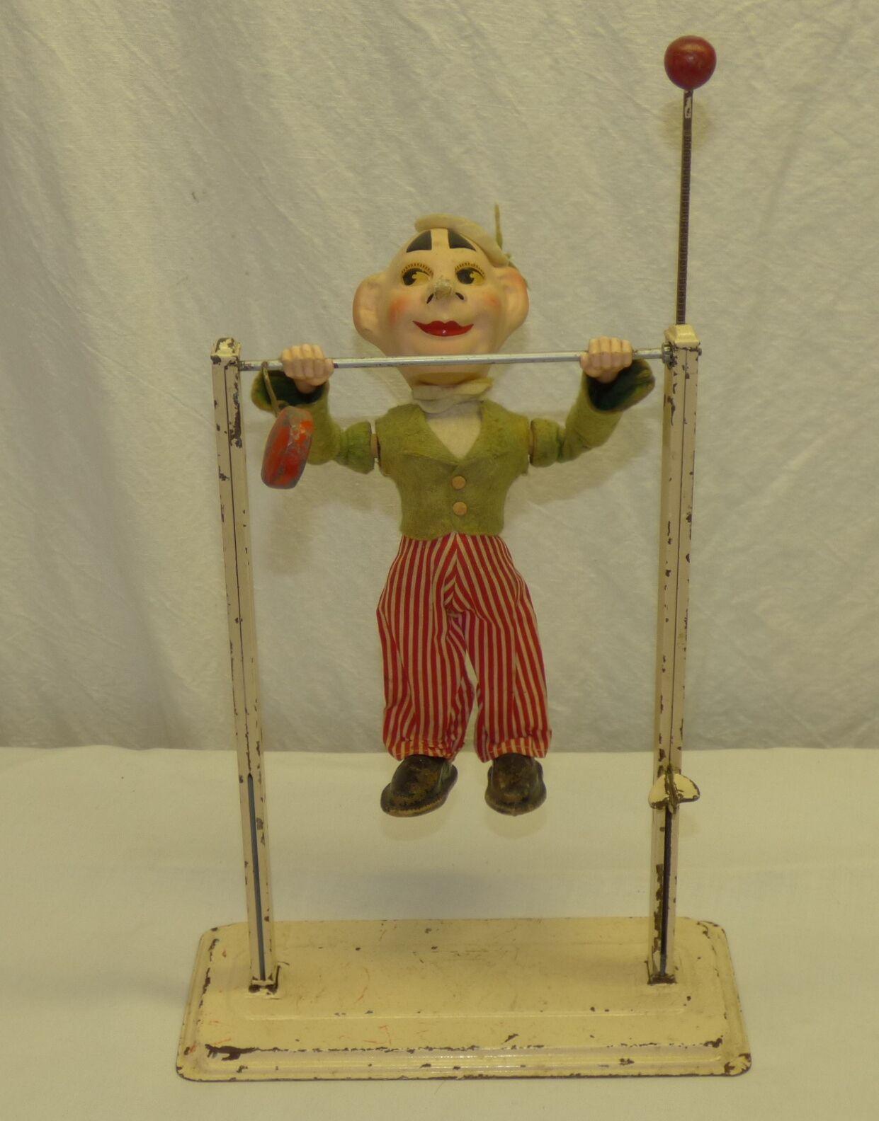 Arnold 1950s viejo nos zona Alemania metal y papel maché mecánico Acrobat muñeca de juguete
