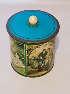 VINTAGE-BISCUIT-BARREL-TIN-WITH-SUCTION-LID-LOVERS-THEME