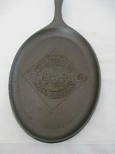 TABASCO-CAST-IRON-SKILLET-McILHENNY-CO-OVAL-SHAPED-EMBOSSED-TABASCO-LOGO