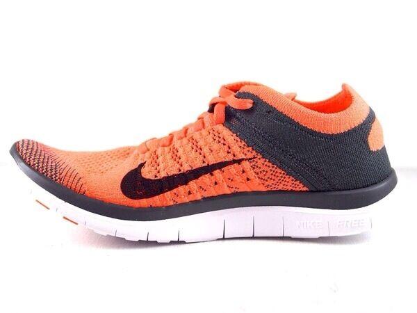 Le donne con le scarpe nike libera flayknit 100% neri / orange autentico