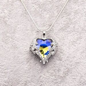 Angel-Wings-Heart-Pendant-With-Purple-And-White-Crystals-On-Silver-Necklace