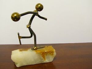 Man-Playing-Ball-Made-of-Metal-Nuts-and-Bolts-Figurine