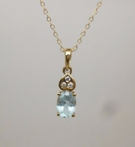 9ct-375-yellow-gold-oval-cut-topaz-and-diamond-pendant-amp-16-034-belcher-chain