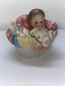 Vintage Napco Baby Nursery Planter Ceramic Baby in Basket of Clothes A-5575 1962