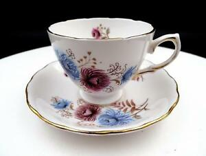 "ROYAL VALE ENGLAND PINK AND BLUE FLORAL GOLD TRIM 2 5/8"" CUP AND SAUCER SET"