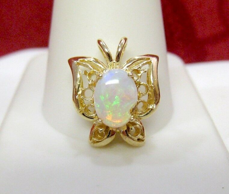 14K 585 YELLOW gold BUTTERFLY PENDANT WITH NATURAL OVAL OPAL