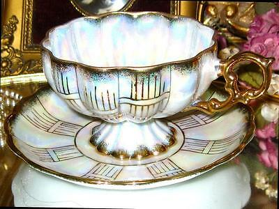 ROYAL SEALY china WHITE & GOLD IRIDESCENT FOOTED RAISED MOLD TEA CUP AND SAUCER