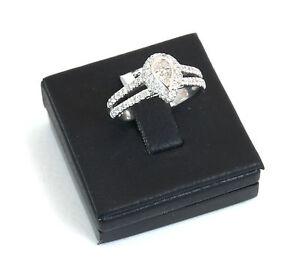Anello-oro-bianco-18kt-con-2-diamanti-centrali-taglio-goccia-totale-caratura0-55