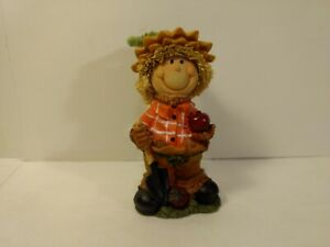 Greenbrier-Scarecrow-Kid-With-Shovel-amp-Apples-Polystone-Fall-Decoration-h152