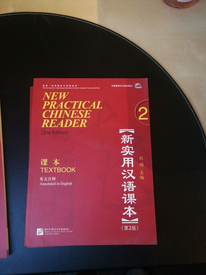 New practical chinese reader, Både text og work book, 2