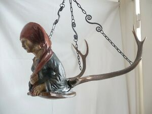 black forest carved figural chandelier damsel or lady with