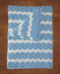 #5 hand crocheted baby blanket in white with puppy motif
