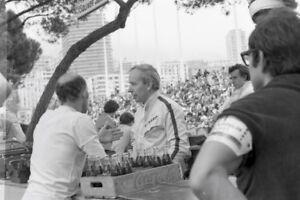 Photo-John-Surtees-Stirling-Moss-talking-1969-Monaco-F1-GP-Grand-Prix