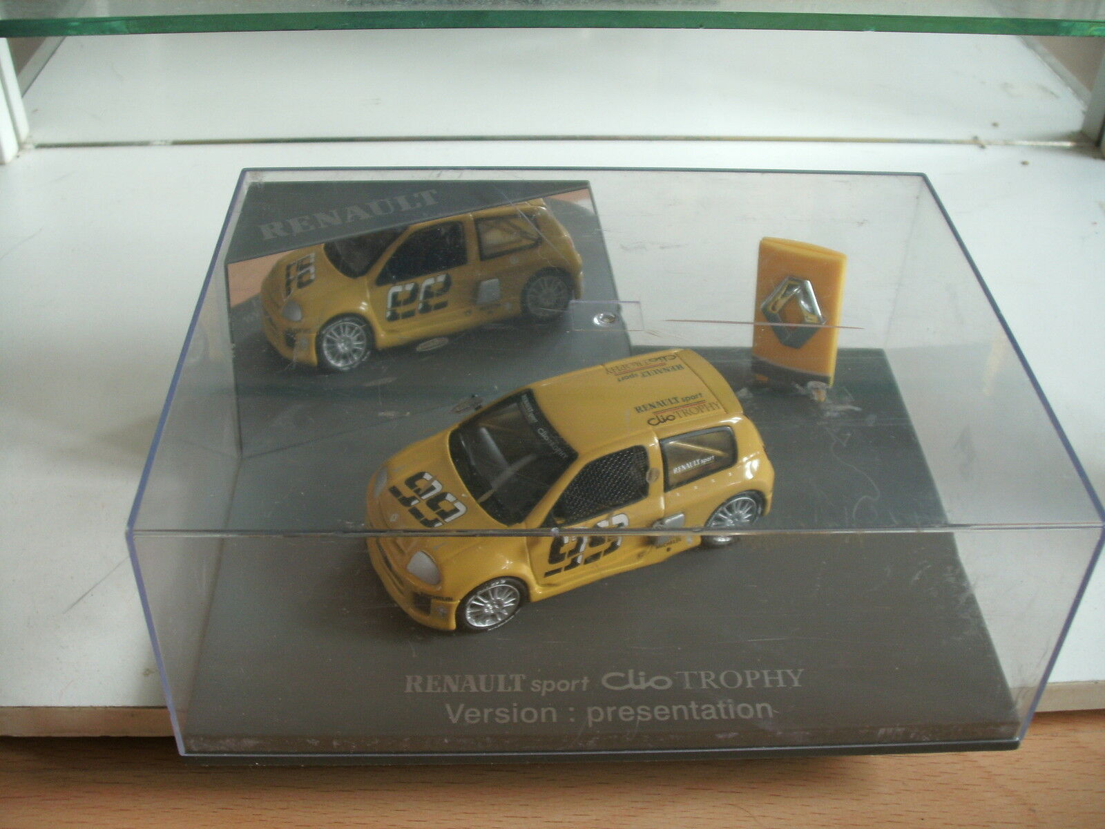 Universal Hobbies Renault Clio Trophy Presentation in Yellow on 1 43 In Box