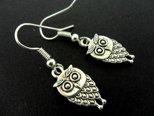 NEW. A PAIR OF  CUTE LITTLE TIBETAN SILVER DANGLY OWL EARRINGS