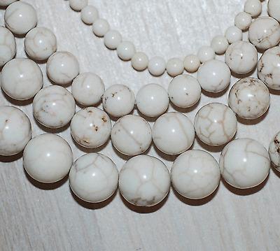 Magnesit weiße Perlen mit leichter brauner Struktur Kugeln 4-12 mm, 1 Strang
