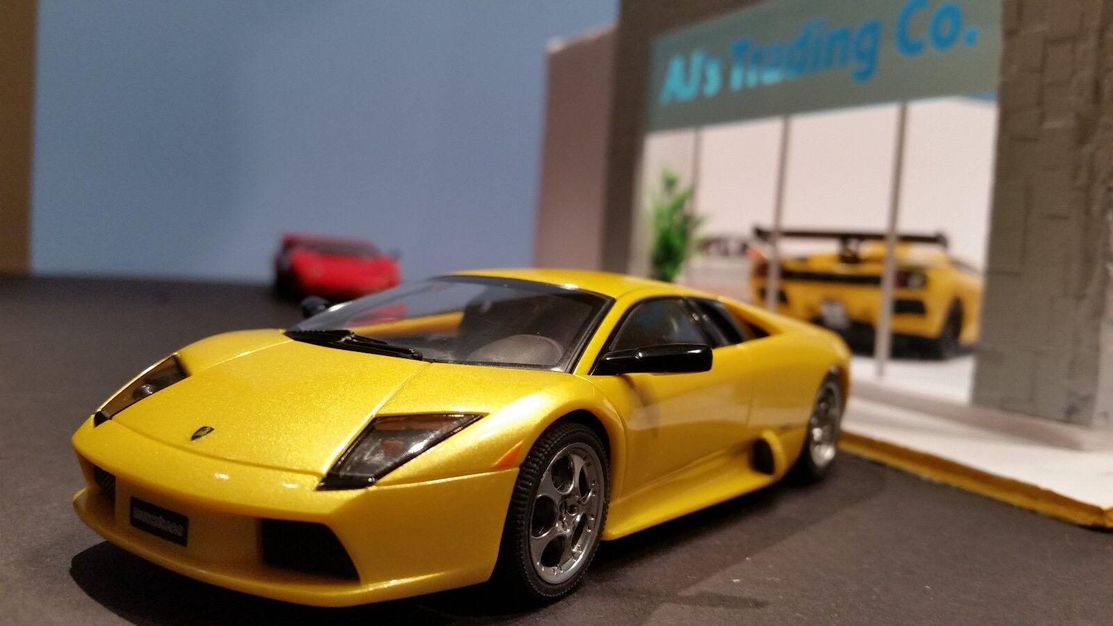 Auto tigre 1  32 Lamborghini murcielago luz amarilla nueva caja