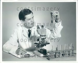 Lab-Technician-in-White-Coat-With-Microscope-amp-Test-Tubes-Press-Photo