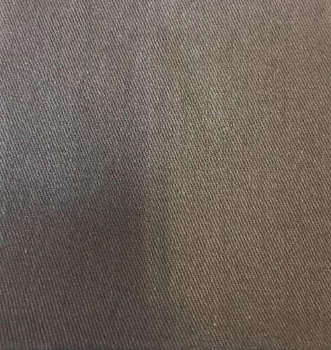 Parches de reparación de hierro en un par de gris oscuro