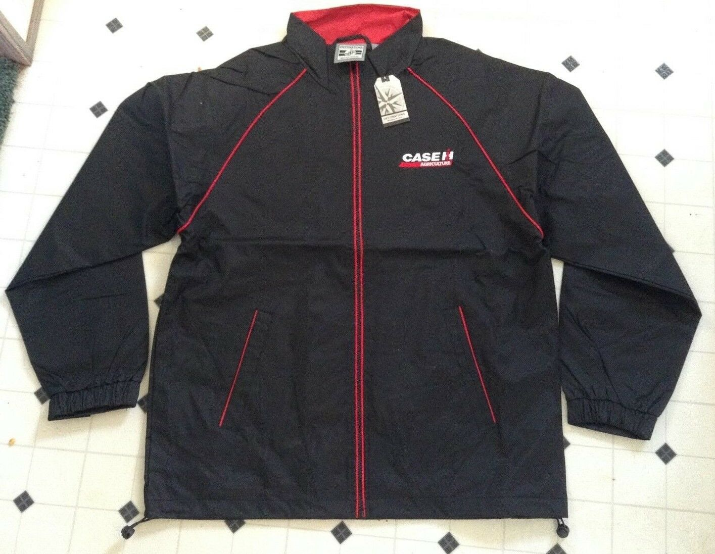 A New CaseIH Extra Large Zip Up Rain Jacket With No Hood