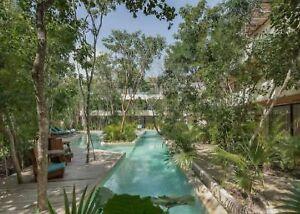 Departamento con areas verdes, alberca climatizada,  en Aldea Zama