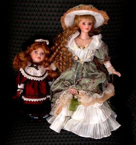 I have 2 Ashley Belle Porcelain Dolls both in wooden cases ...