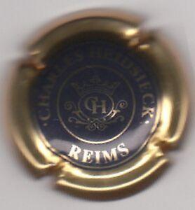 capsule-de-champagne-CHARLES-HEIDSIECK-centre-bleu-noir-contour-or