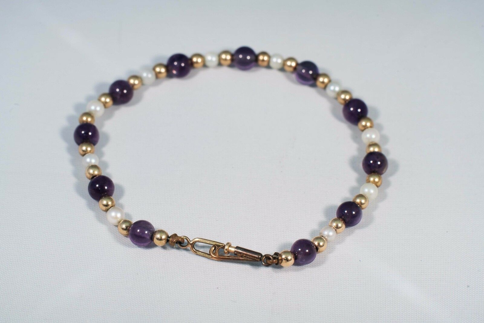 14K Yellow gold Amethyst, Pearl and gold Bead Bracelet, 5.75  long