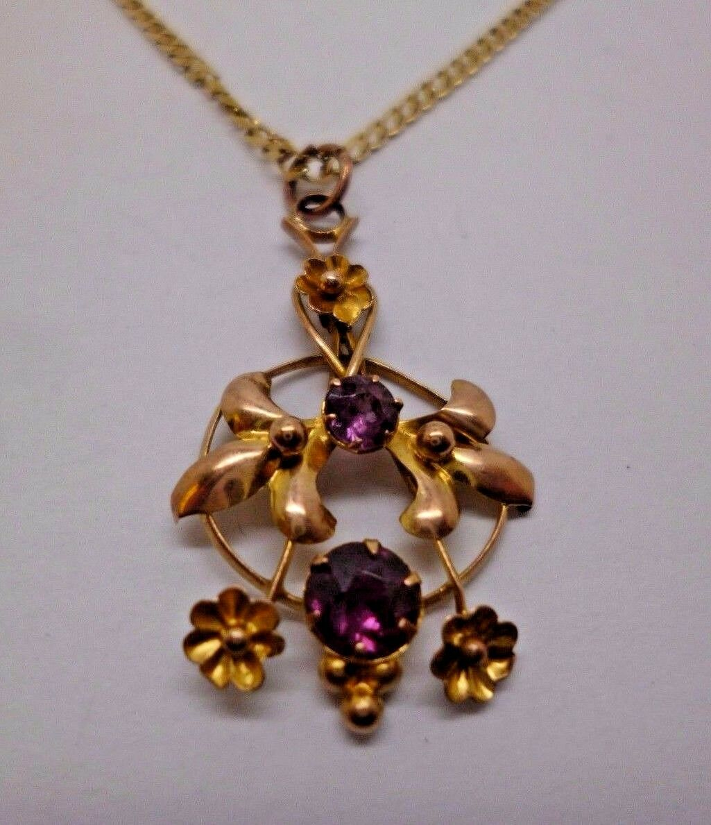 9ct yellow gold amethyst antique pendant with 18' curb chain,  '375'