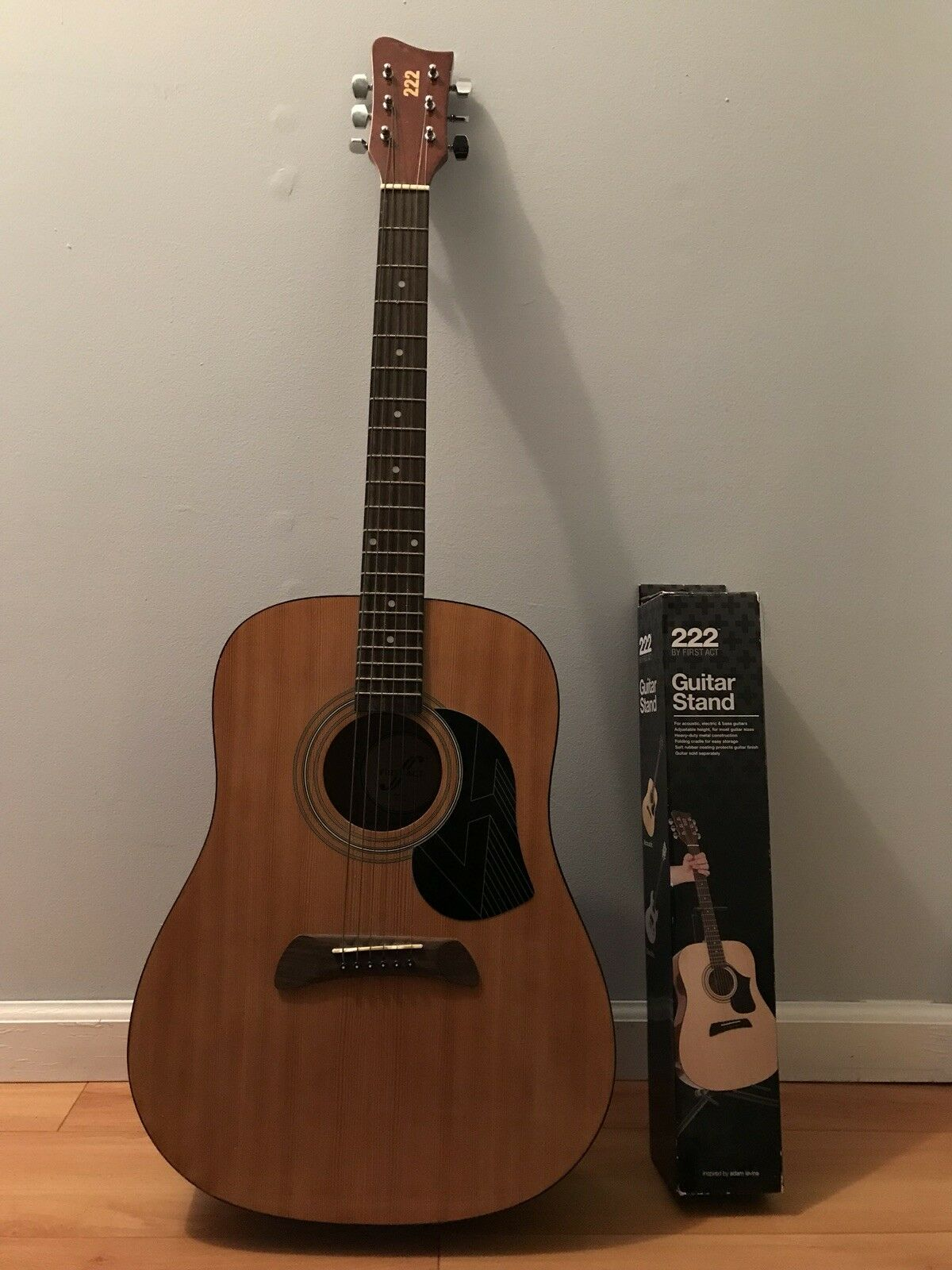 Acoustic guitar 222 by first act, includes stand.