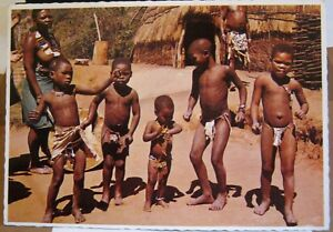 South-Africa-Transkei-Mother-and-Group-young-Bantu-warriors-posted-1975