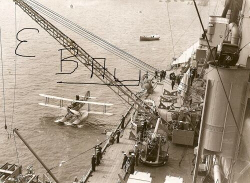1930/'S ACTION 8X10 BRITISH NAVY BI-PLANE PULLING UP NEXT TO A SHIP AT SEA LOOK