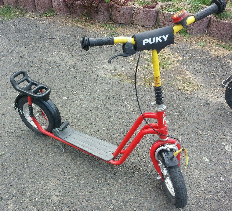 Alter roter PUKY Roller - mit aufblasbaren Reifen Gepäckträger Handbremse