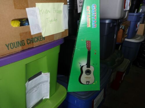 kids guitar  six strings about 24 inches tall nice gift priced right