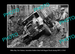 OLD-POSTCARD-SIZE-PHOTO-MILNE-BAY-PNG-AUSTRALIAN-TROOPS-BOGGED-IN-WWII-c1942