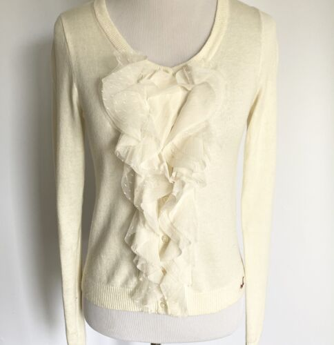 Ivory colored lace trimmed top....front buttons...long sleeves....vintage