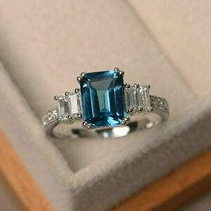 2-25Ct-Emerald-Cut-Blue-Topaz-Solitaire-Engagement-Ring-14K-White-Gold-Over