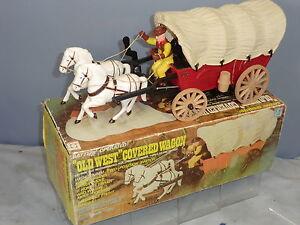 Wagon couvert    à piles en plastique Mib  old West