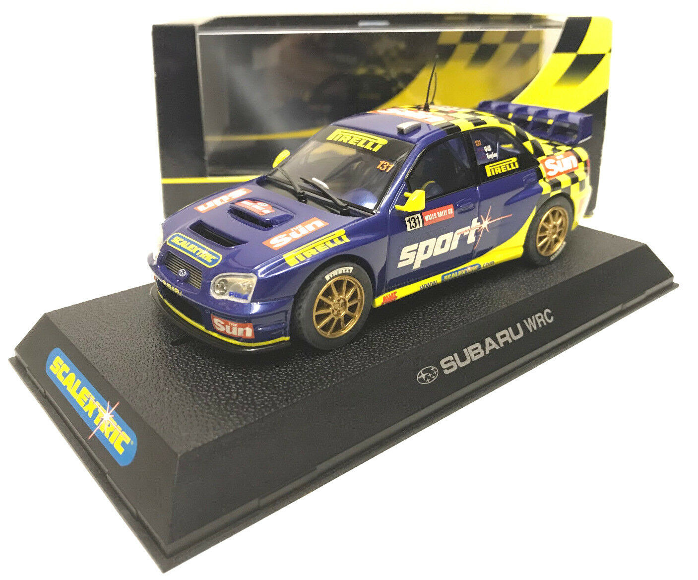 Scalextric C2550 Subaru Impreza Wales WRC The Sun Slot Car bluee Yellow New