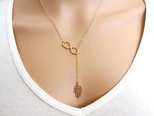 Idée cadeau bijou fantaisie , collier chaine dorée , main de fatma et infini