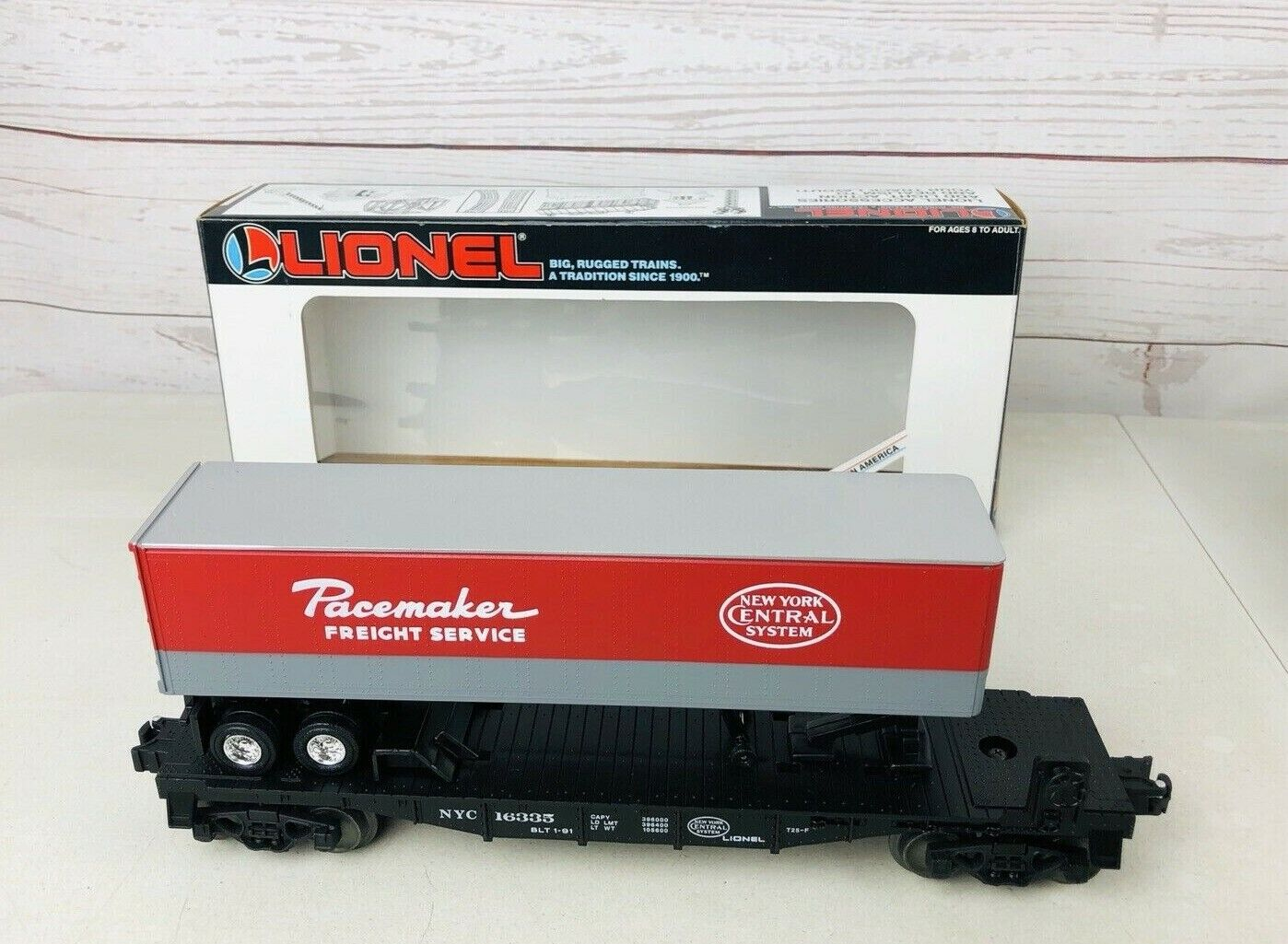 LIONEL O SCALE NEW YORK CENTRAL NYC FLATCAR WITH PACEMAKER TRAILER  6-16335