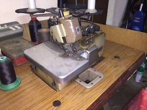 Overlocker industrial machine. Sewing fabric machine curtain
