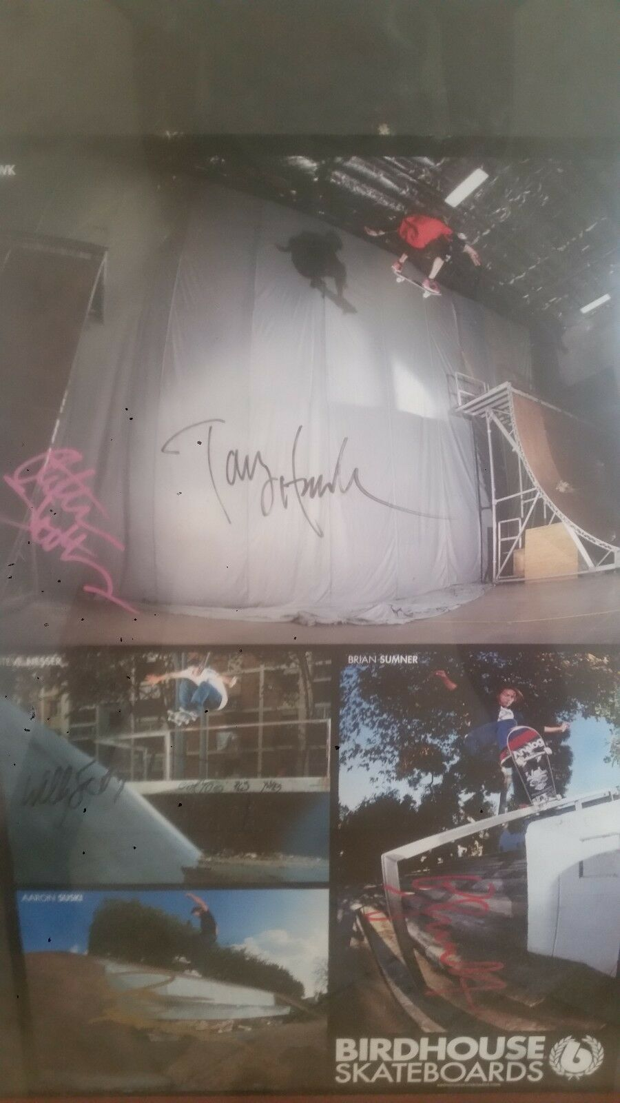 Poster signed by tony hawk, steve nesser, aaron suski and brian sumner.
