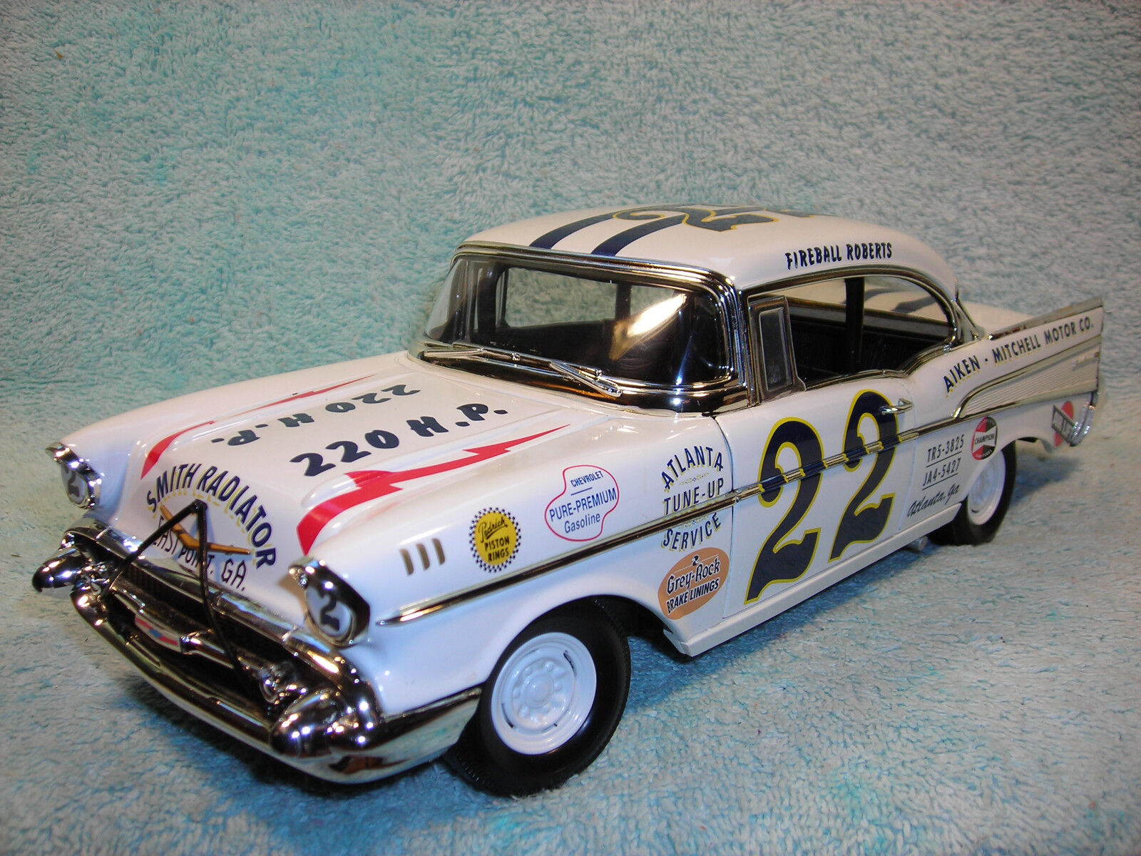 1 18 1957 CHEVY  BEL-AIR IN WHITE GRAPHICS BY ERTL AMERICAN MUSCLE NO BOX.